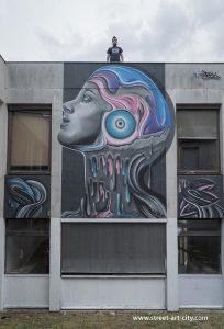Visage féminin sur une façade de Street Art City